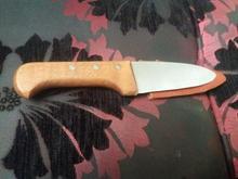 یک عدد چاقو تیز در شیپور-عکس کوچک