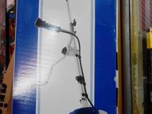 علف زن هیوندای کره اکبند. یونجه چین. علف تراش در شیپور-عکس کوچک