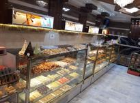 فروشنده در شیرینی فروشی در شیپور-عکس کوچک