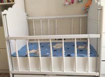 تخت نوزاد همراه با آویز موزیکال در شیپور-عکس کوچک
