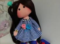 عروسک روسی با موهای مشکی و لباس ابی در شیپور-عکس کوچک