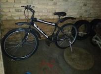 دوچرخه تمیز است لاستیک کارکره در شیپور-عکس کوچک